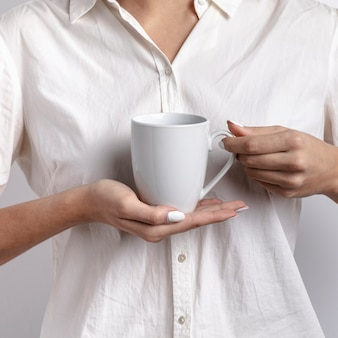 Front view of woman holding a mug