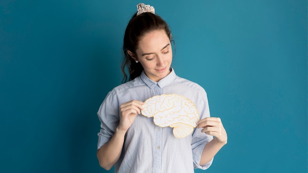 Front view woman holding paper brain