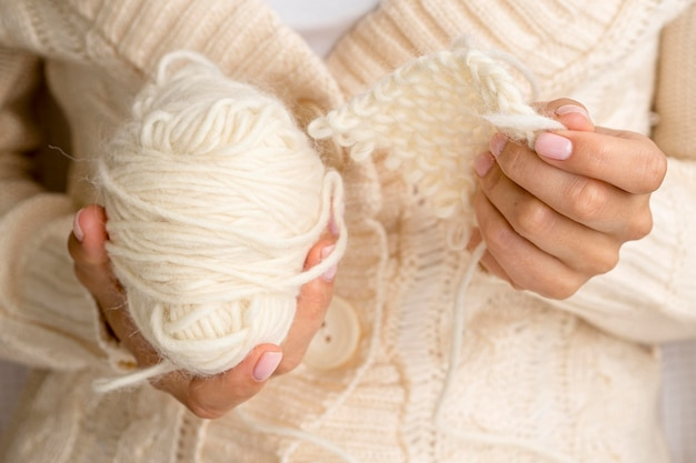 Front view of woman holding yarn