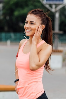 Front view of woman listening on headphones