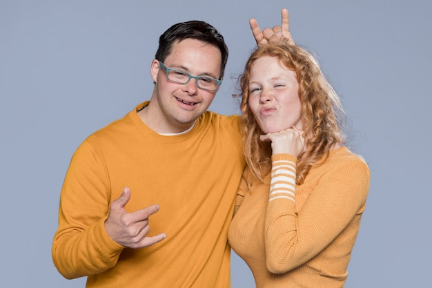 Front view woman and man posing together in studio