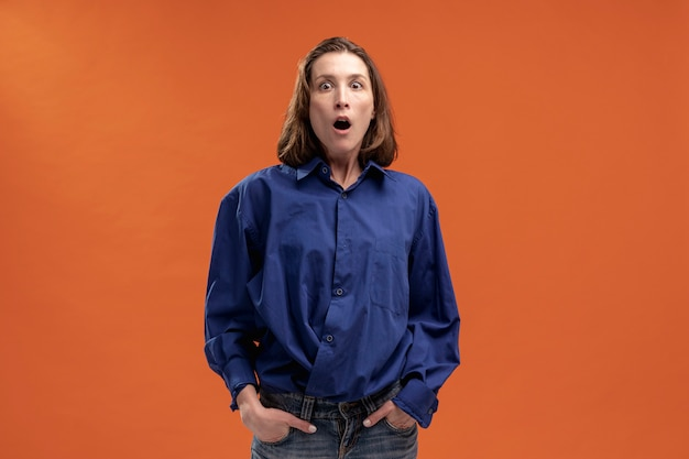 Front view of woman posing and acting shocked
