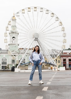 Front view woman posing in an amusement park