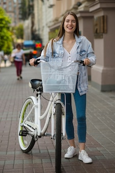 Front view woman posing with bike