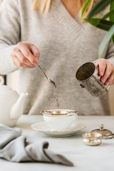Front view of woman preparing tea