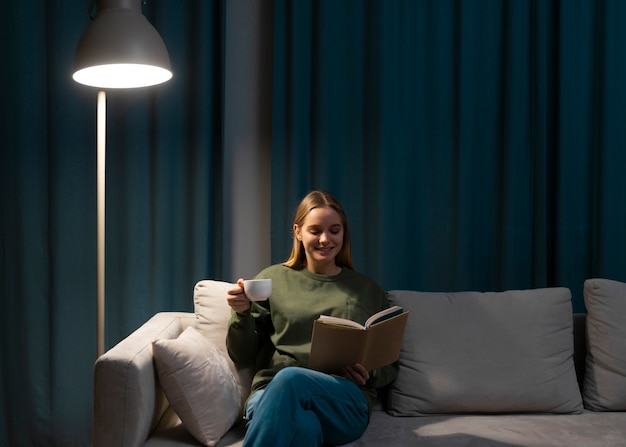 Front view of woman reading on couch