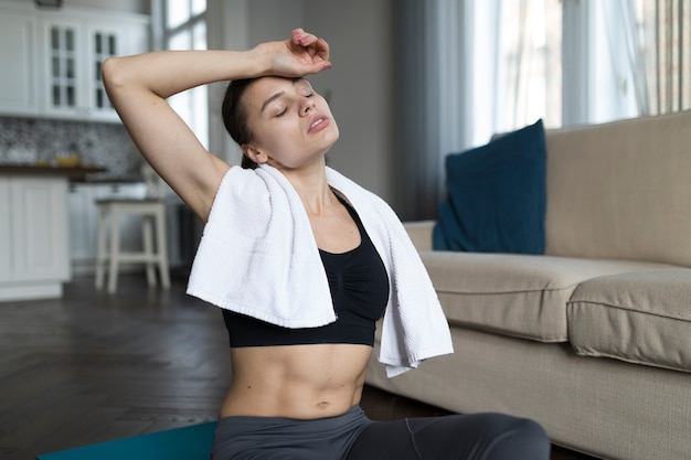 Front view of woman relaxing after exercising
