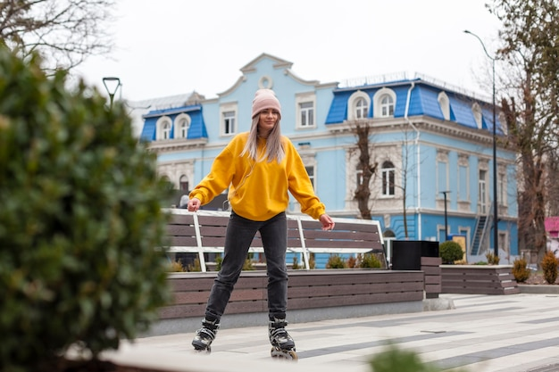 Front view of woman rollerblading in the city