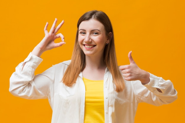 Front view woman showing ok sign