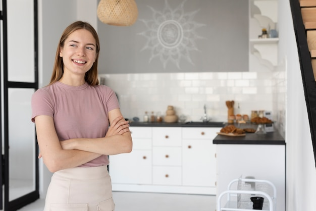 Front view woman standing in the kitchen