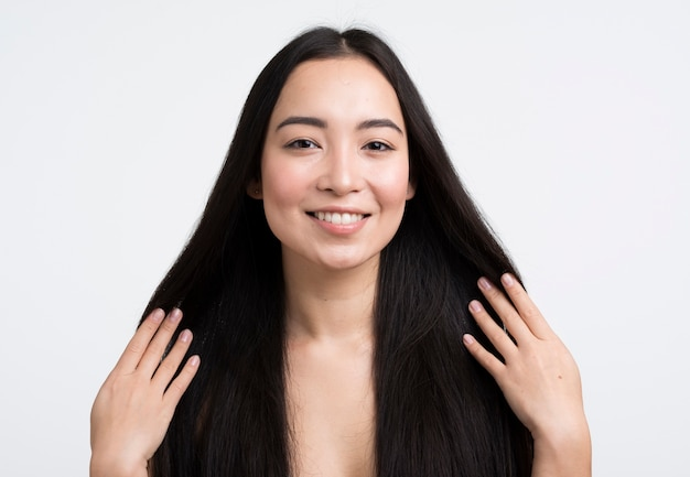 Front view woman touching her hair