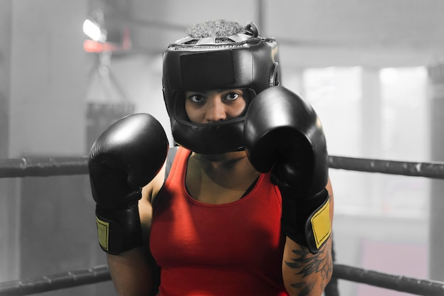 Front view woman training for a boxing competition