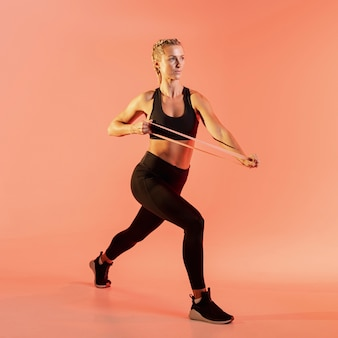 Front view woman training with elastic band