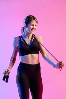 Front view woman training with jumping rope