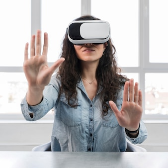 Front view woman and virtual reality headset
