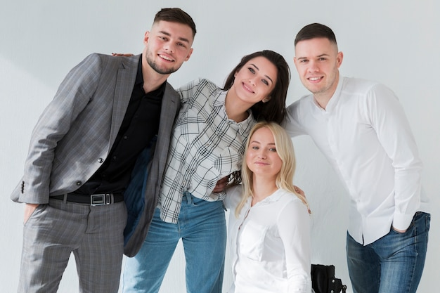 Front view of woman in wheelchair posing with her coworkers