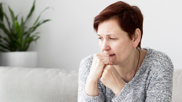 Front view of woman with anxiety on couch