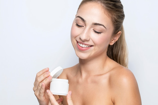 Front view of woman with beauty product concept