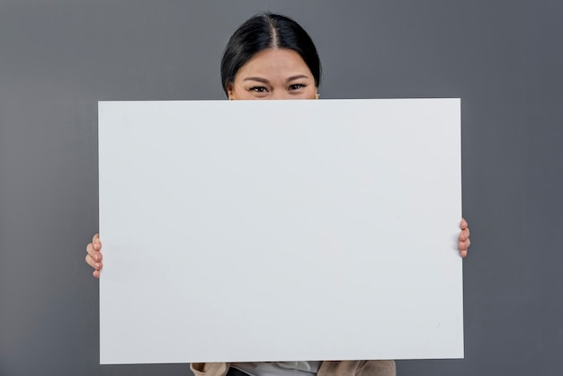 Front view woman with blank paper sheet