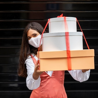 Front view of woman with boxes