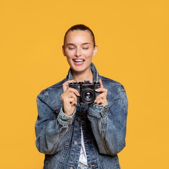 Front view of woman with camera