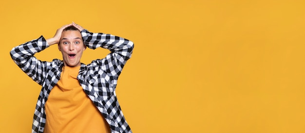 Front view of woman with checkered shirt and copy space