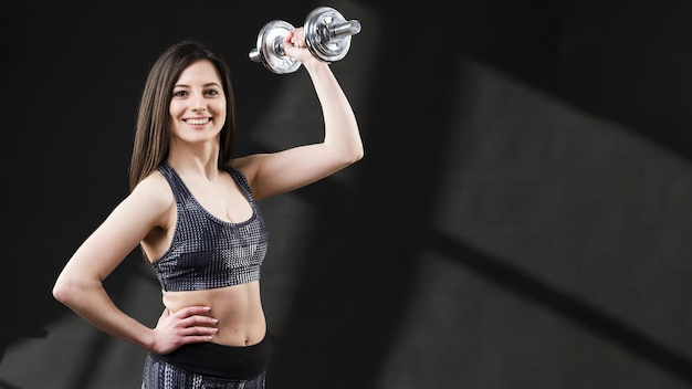 Front view of woman with dumbbells