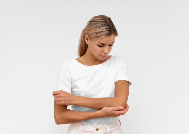Front view of woman with elbow pain
