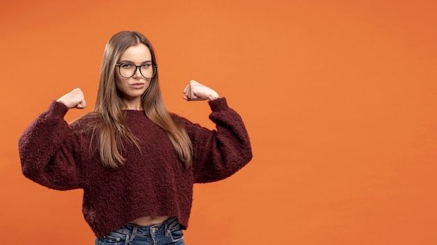 Front view of woman with glasses being victorious