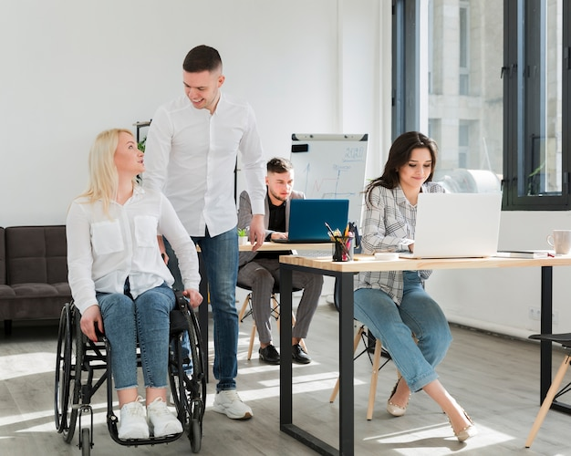 Front view of woman with her coworkers in office