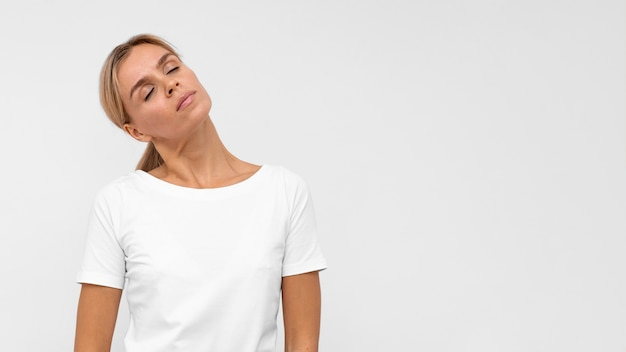 Front view of woman with neck pain and copy space