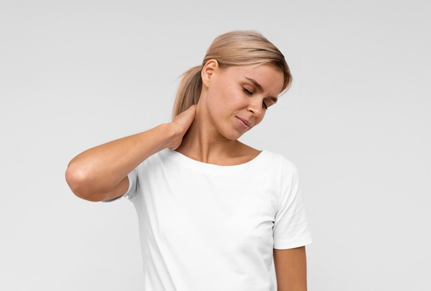 Front view of woman with neck pain