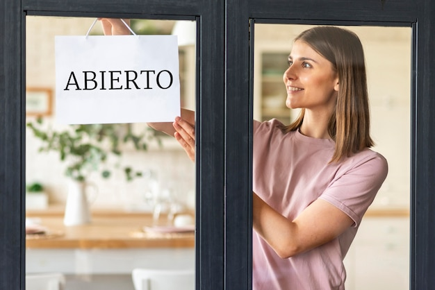 Front view of woman with open sign