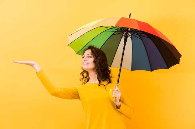 Front view of woman with rainbow umbrella