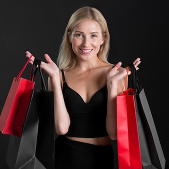 Front view of woman with shopping bag concept