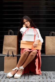 Front view of woman with shopping bags concept