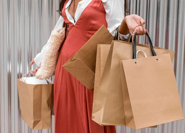 Front view of woman with shopping bags