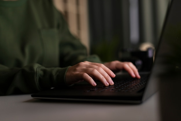 Front view of woman working on laptop