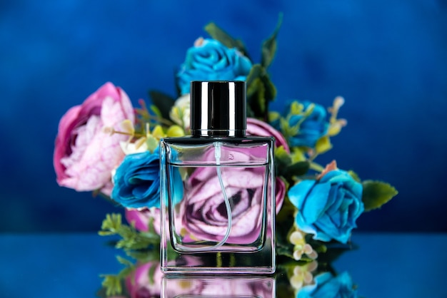 Front view of women perfume colored flowers on dark blue
