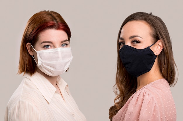 Front view of women with face mask concept