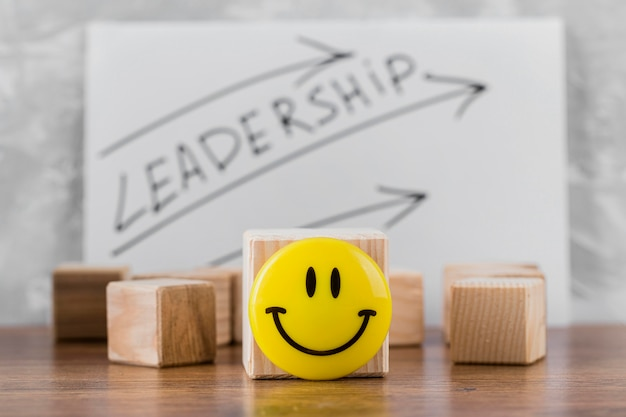 Front view of wooden blocks with leadership