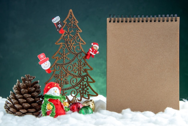 Front view wooden xmas tree with toys pinecone notebook