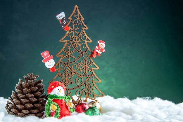 Front view wooden xmas tree with toys pinecone