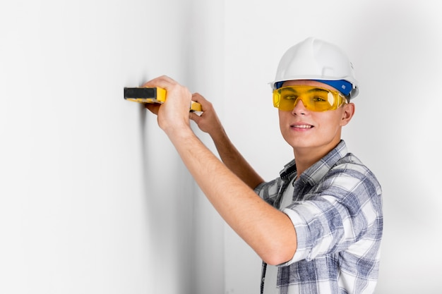 Front view of worker with spirit level