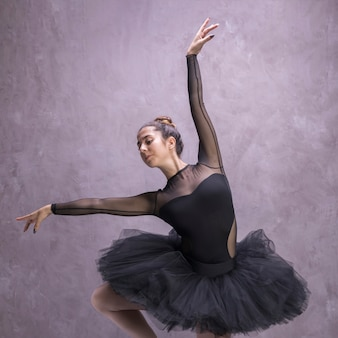 Front view young ballerina posing