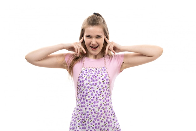 A front view young beautiful housewife in pink shirt colorful cape screaming shout posing with hands
