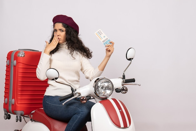 Front view young female on bike holding ticket on white background speed city vehicle vacation flight color road
