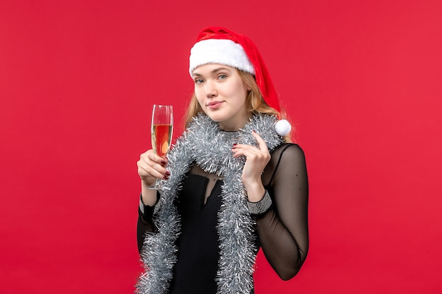 Front view young female celebrating new year on red wall emotion christmas holidays