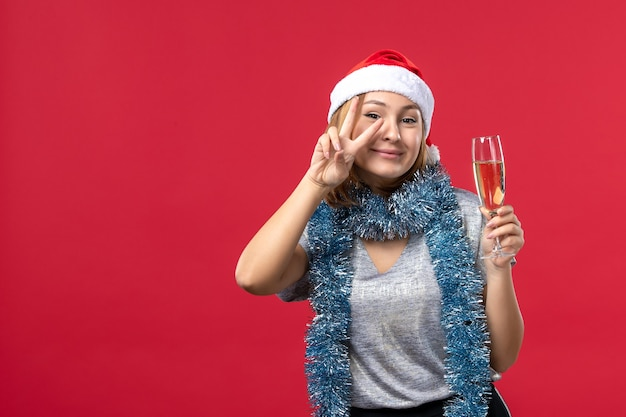 Front view young female celebrating new years coming on red wall color christmas holiday