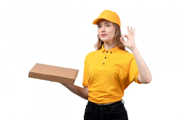 A front view young female courier female worker of food delivery service holding pizza box on white